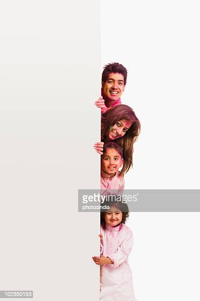 Couple celebrating Holi with their children
