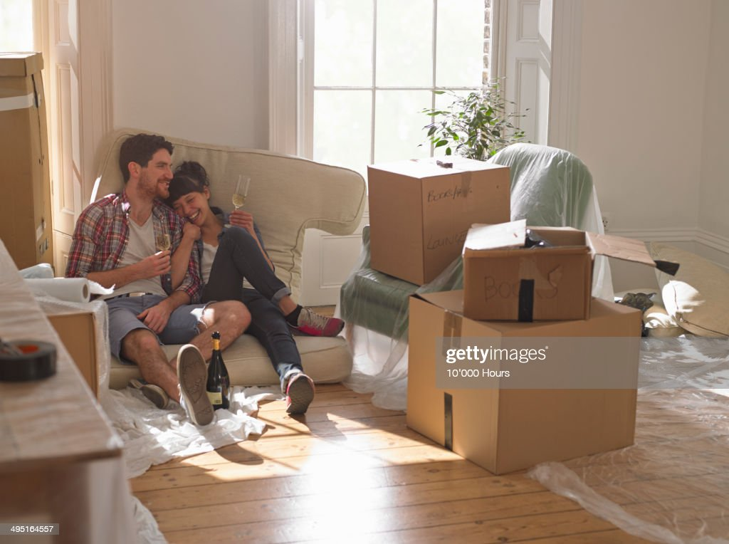 A couple celebrating moving into their new home : Stock Photo