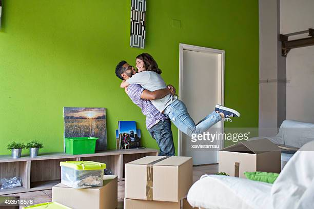 Couple celebrating moving to their new home