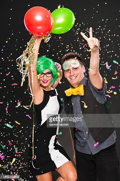 Couple celebrating New Year's Day, Party or Carnival, studio shot