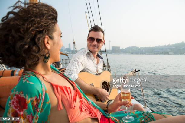Couple Celebrating on a Sailboat
