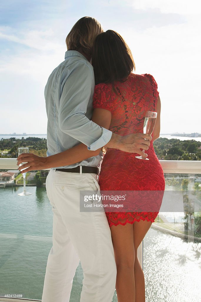 Couple celebrating with champagne : Stock Photo