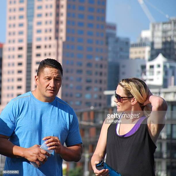 Couple Chatting against an Urban Scene