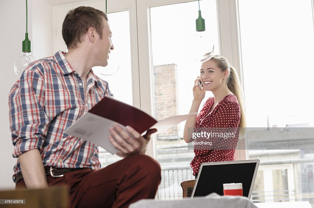 Couple chatting at home : Stock Photo