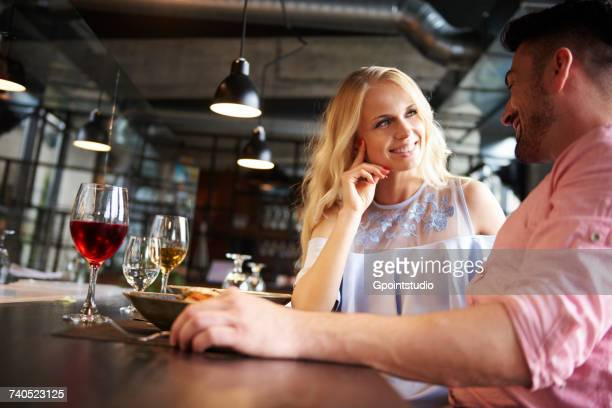 Couple chatting at restaurant table