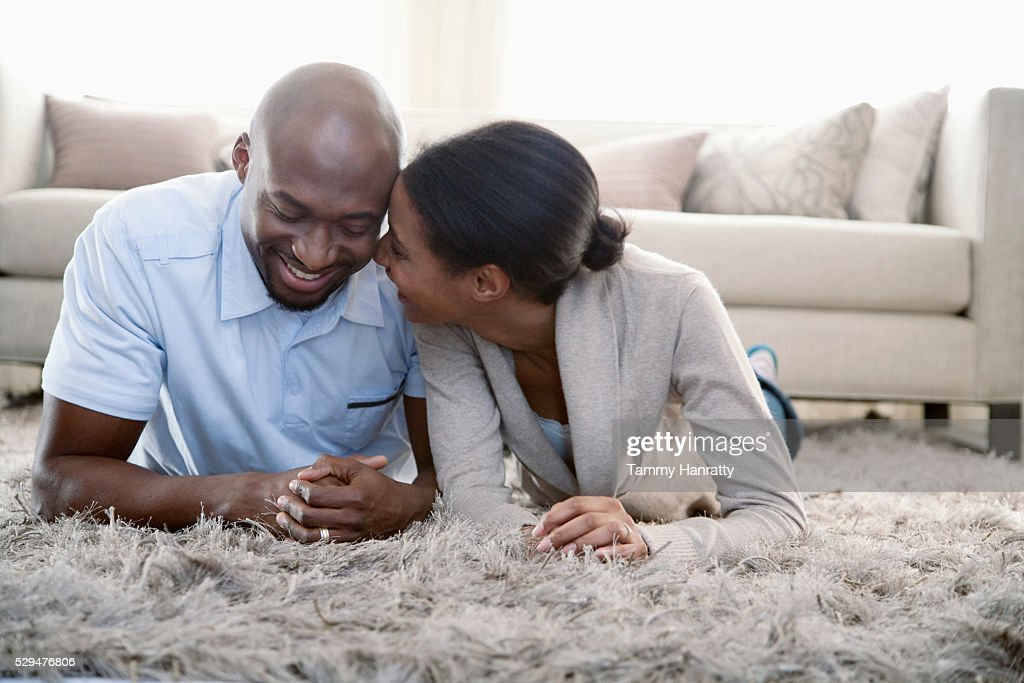 Couple chatting on the floor : Stock Photo