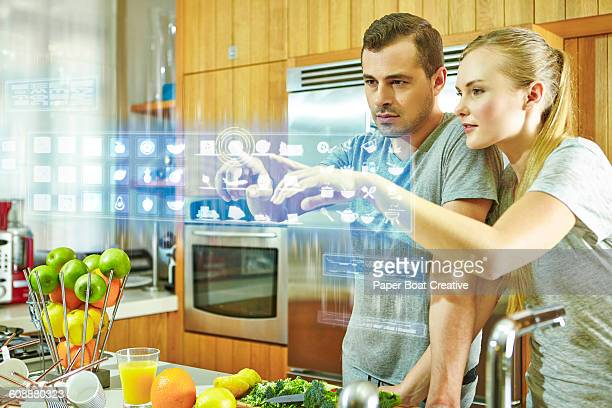 Couple checking different apps on a hologram