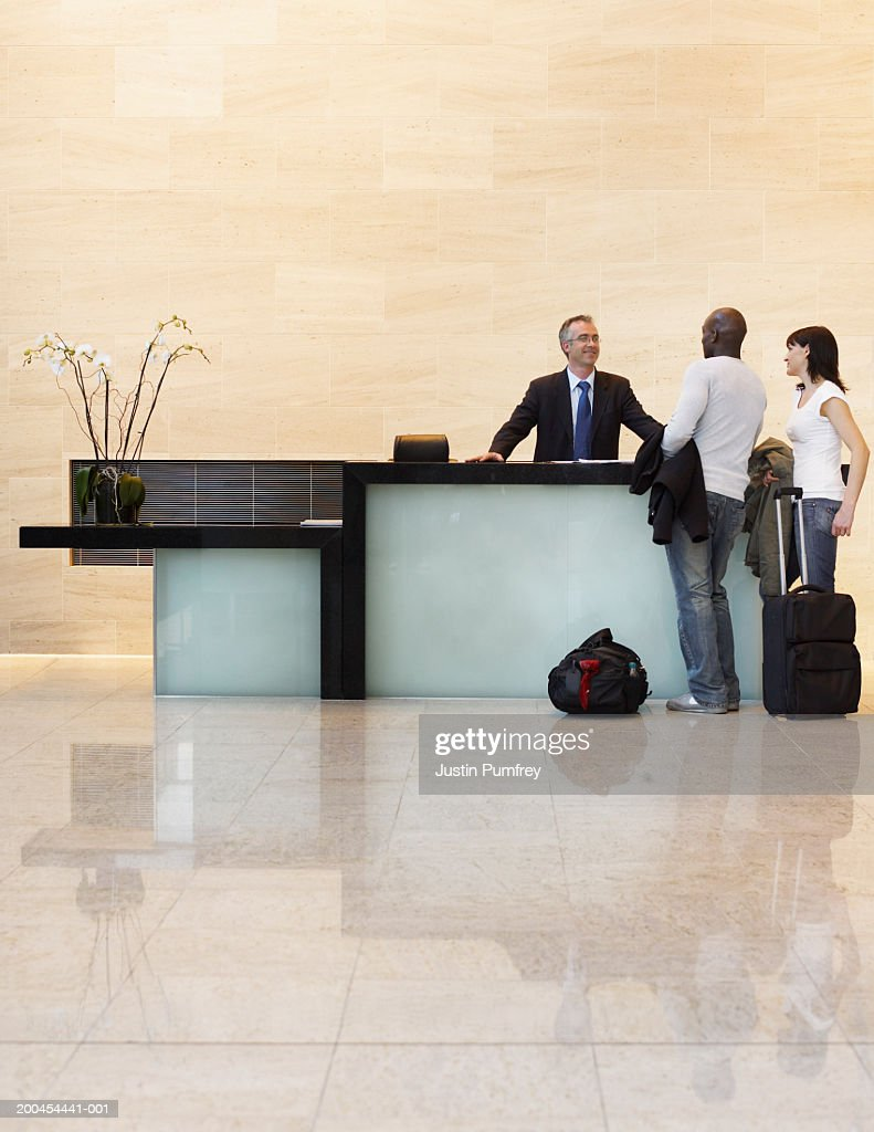 Couple checking in to hotel