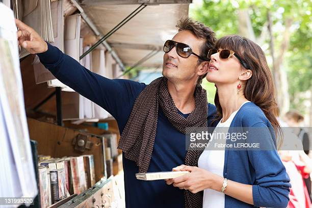 Couple choosing books at a book stall, Paris, Ile-de-France, France
