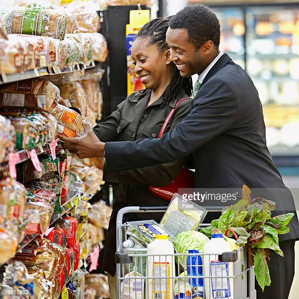 Couple Choosing Bread at Grocery Store