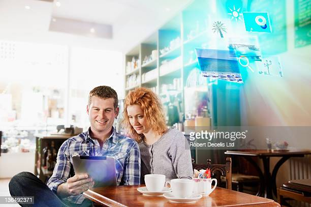 Couple choosing holiday on tablet