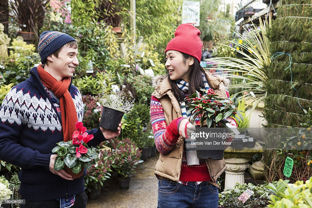 Couple choosing plants in garden centre.. : Stock Photo