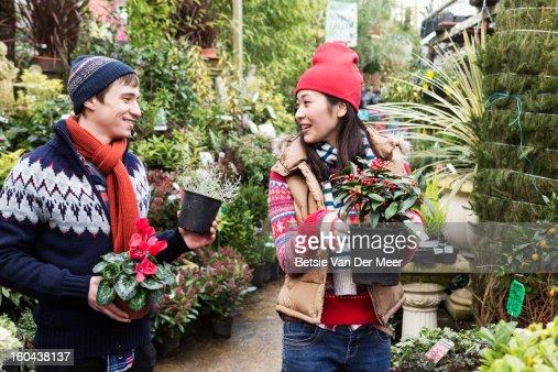 Couple choosing plants in garden centre.. : Stock Photo