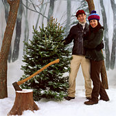 Couple chopping down Christmas tree