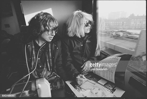 Couple Chris Stein and Debbie Harry of Blondie look out a tour bus window