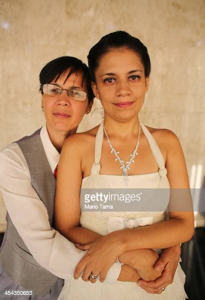 Couple Claudia and Giselle together 7 years pose after marrying at what was billed as the world's largest communal gay wedding on December 8 2013 in...