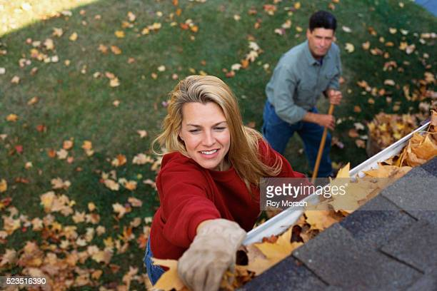 Couple Cleaning Away Leaves