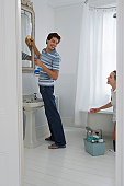 Couple Cleaning the Bathroom Together
