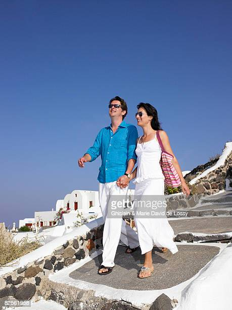 Couple climbing down the stairs