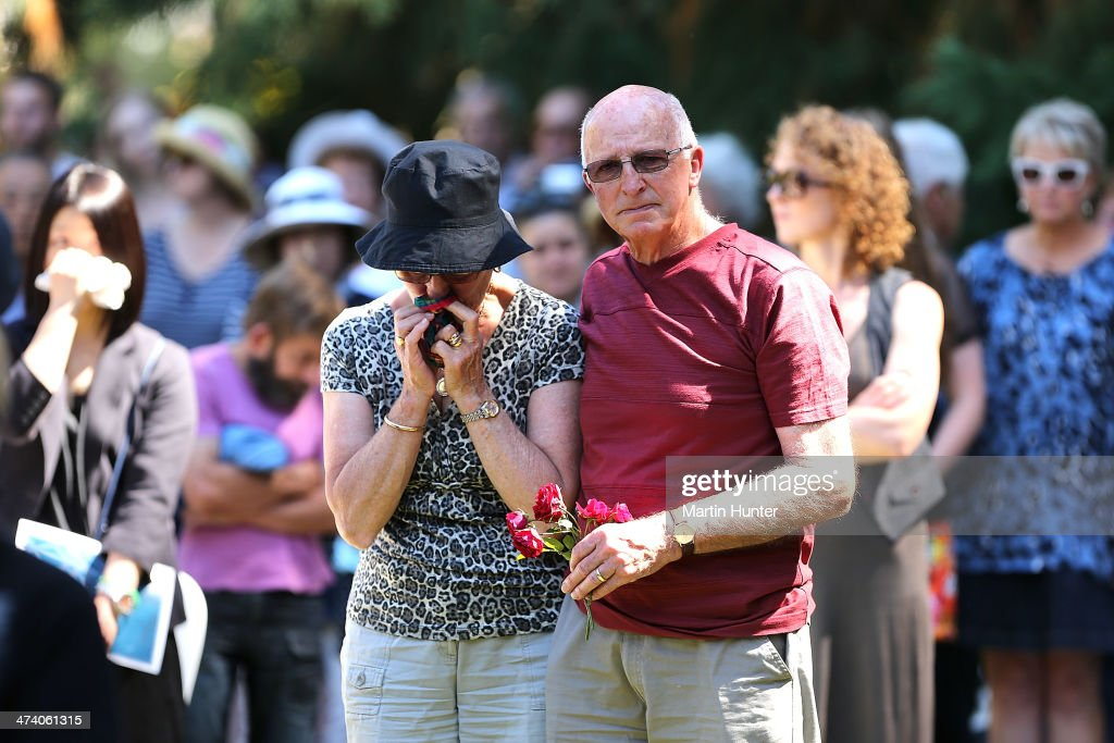 A couple comfort each other during a Civic Memorial Service held in the Botanical Gardens for victims of the 2011 Christchurch Earthquakes on February 22, 2014 in Christchurch, New Zealand. The earthquake measuring 6.3 in magnistude devastated Christchurch killing 185 people and causing an estimated $40 billion in damage to the city's buildings and infrastructure.