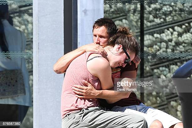 A couple comfort each other outside the Pasteur hospital on July 16 2016 in Nice France Five people believed to be linked to the man who killed 84...