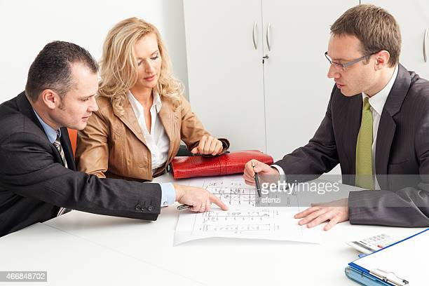Couple Consulting Buying New House
