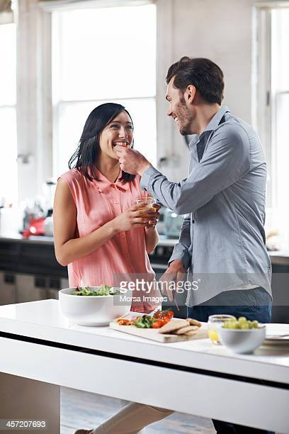 Couple cooking and tasting food