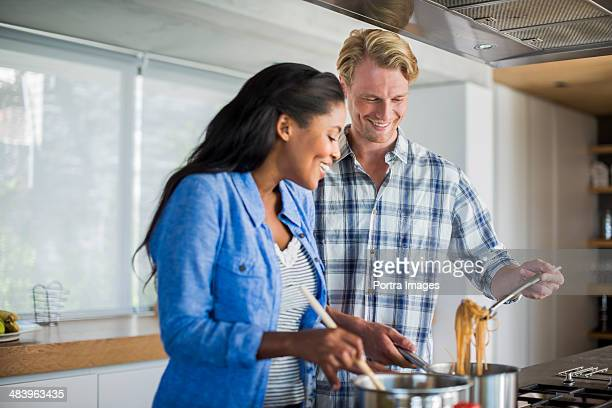 Couple cooking pasta together