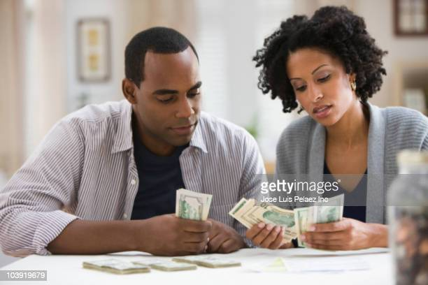 Couple counting money