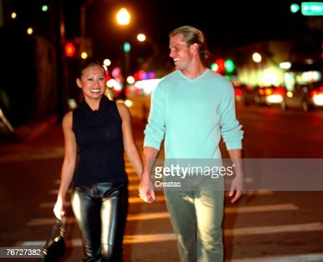 Couple crossing a street : Stock Photo