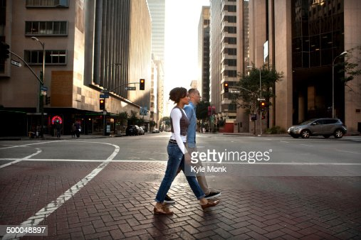 Couple crossing city street