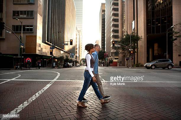 Couple crossing city street