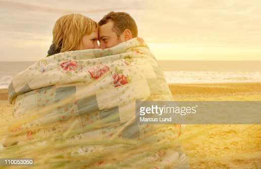 cuddling under a blanket
