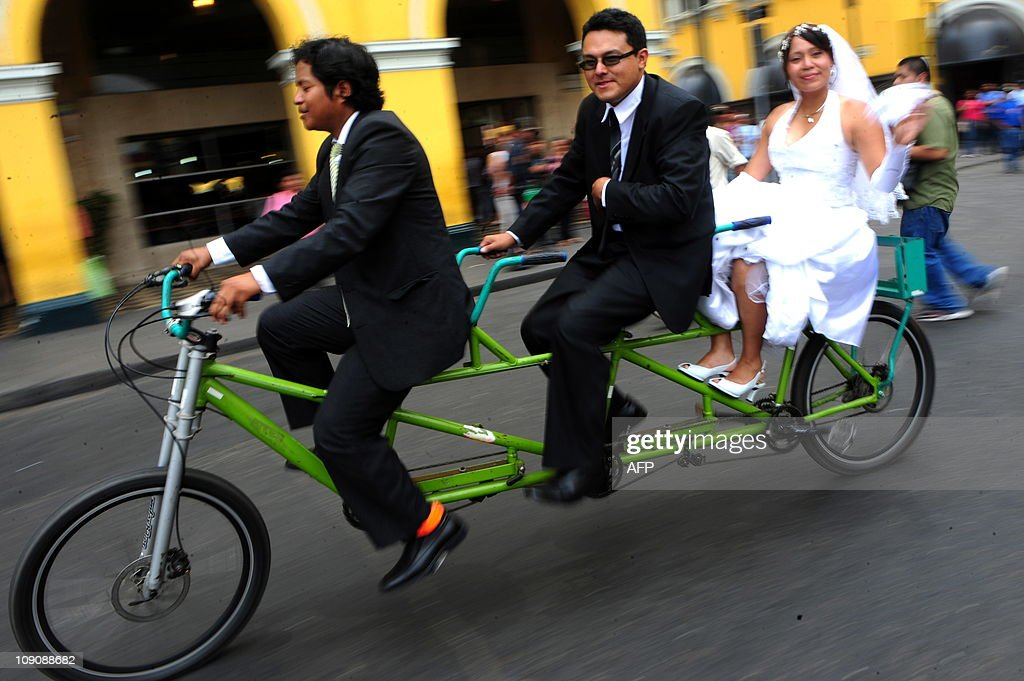 A couple cycles around Lima after getting married on Valentine's Day on February 14, 2011. Love swept around the world Monday as the amorous mixed traditional chocolates and roses with new and more determined ways to demonstrate their ardour on Valentine's Day.