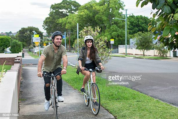 Couple cycling down the street