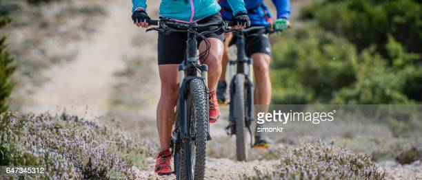 Couple cycling on bicycle trail