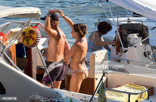 A couple dance on their power boat on the day of the Redentore Celebration on July 19 2014 in Venice Italy Redentore which is in remembrance of the...