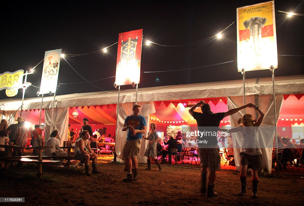 A couple dance outside a late night bar at the Glastonbury Festival site at Worthy Farm, Pilton on June 27, 2011. This year's festival featured headline acts U2, Coldplay and Beyonce. The festival, which started in 1970 when several hundred hippies paid 1 GBP to watch Marc Bolan, has grown into Europe's largest music festival attracting more than 175,000 people over five days.