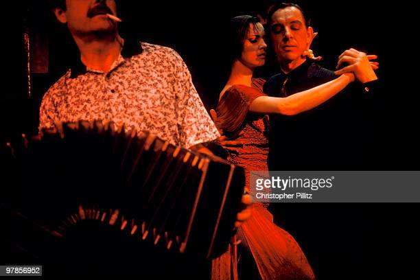 A couple dance to the Tango sounds of an accordian