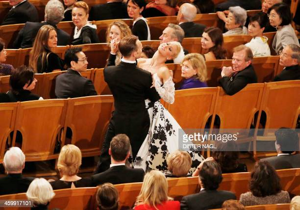 A couple dances in the 'Golden Hall' as Israeli Argentineborn conductor Daniel Barenboim conducts the Vienna Philharmonic Orchestra during the New...