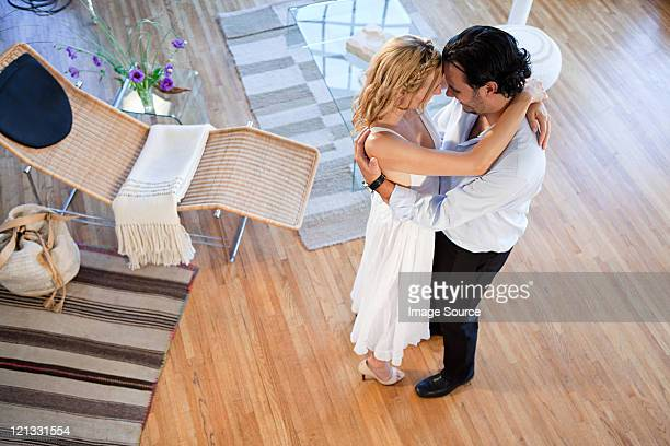 Couple dancing at home, high angle view