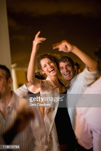 Couple dancing at party at night : Stock Photo
