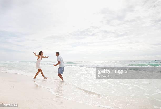 couple dancing beach