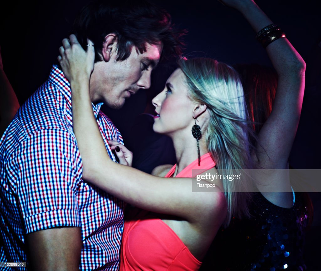 Couple dancing, getting close on the dance floor : Stock Photo