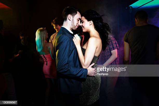 Couple dancing, getting close on the dance floor