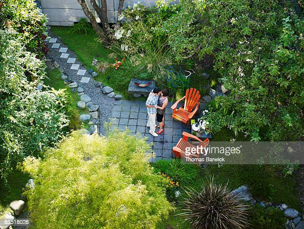 Couple Dancing in backyard garden, overhead view