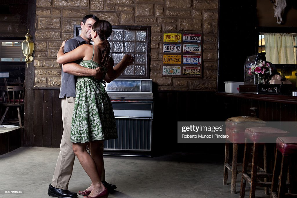 Couple dancing in front of jukebox