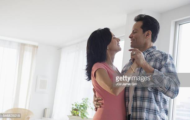 Couple dancing in living room