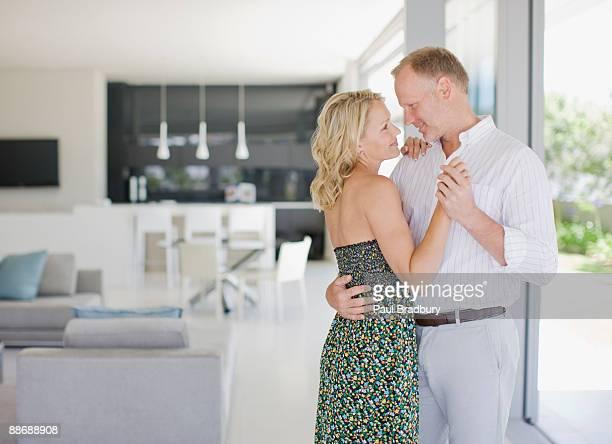 Couple dancing in livingroom