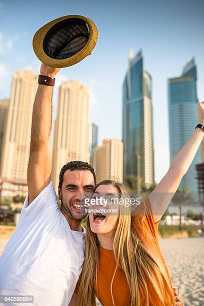 couple dancing on a beach party in dubai marina beach